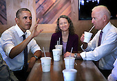 United States President Barack Obama (L) and Vice President Joseph Biden (R) meet with local workers, including Meredith Upchurch (C), at the Dupont Circle location of restaurant chain Shake Shack May 16, 2014 in Washington, DC. President Obama and Vice President Biden met with the workers to discuss increasing investment in re-building America's infrastructure for the future. <br /> Credit: Alex Wong / Pool via CNP
