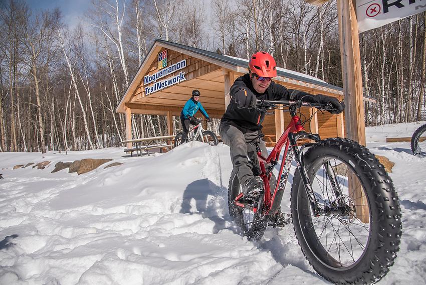 Fatbiking at the Noquemanon Trails Network South Trails trailhead in winter at Marquette, Michigan.