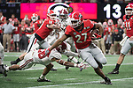 ATLANTA, GA - JANUARY 08: Nick Chubb #27 of the Georgia Bulldogs is tackled by Anthony Averett #28 of the Alabama Crimson Tide during the College Football Playoff National Championship held at Mercedes-Benz Stadium on January 8, 2018 in Atlanta, Georgia. Alabama defeated Georgia 26-23 for the national title. (Photo by Jamie Schwaberow/Getty Images)