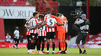 Brentford players form a huddle ahead of kick-off as the Sky TV Cameras monitor their movements during Brentford vs Swansea City, Sky Bet EFL Championship Play-Off Semi-Final 2nd Leg Football at Griffin Park on 29th July 2020