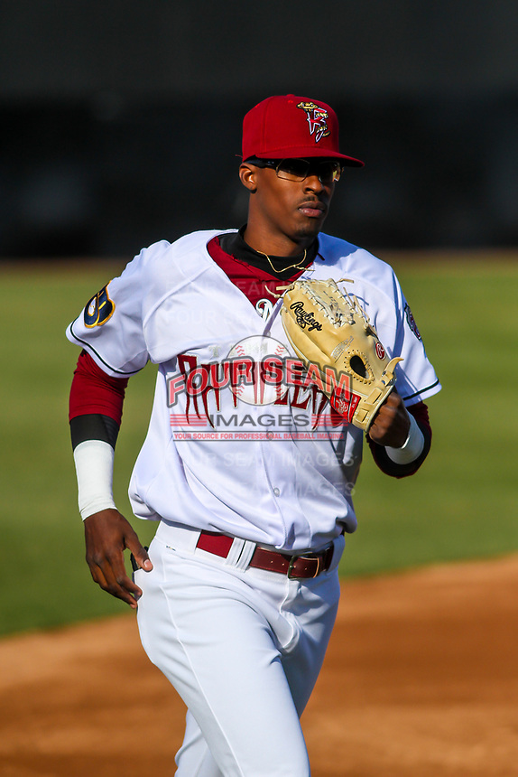 Wisconsin Timber Rattlers outfielder Je'Von Ward (4) jogs in from the outfield between innings during a Midwest League game against the Burlington Bees on April 26, 2019 at Fox Cities Stadium in Appleton, Wisconsin. Wisconsin defeated Burlington 2-0. (Brad Krause/Four Seam Images)