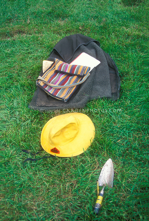 Farmer gardener vacation: gardening hat, coat, trowel, notebook, bag, while gardener is off just vegetating, where's the gardener