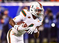 Charlotte, NC - DEC 2, 2017: Miami Hurricanes wide receiver Jeff Thomas (4) runs the football on a kick return during ACC Championship game between Miami and Clemson at Bank of America Stadium Charlotte, North Carolina. (Photo by Phil Peters/Media Images International)