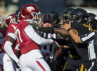 Hawgs Illustrated/BEN GOFF <br /> Officials break up a fight between Arkansas and Missouri players in the first quarter Friday, Nov. 24, 2017, at Reynolds Razorback Stadium in Fayetteville.