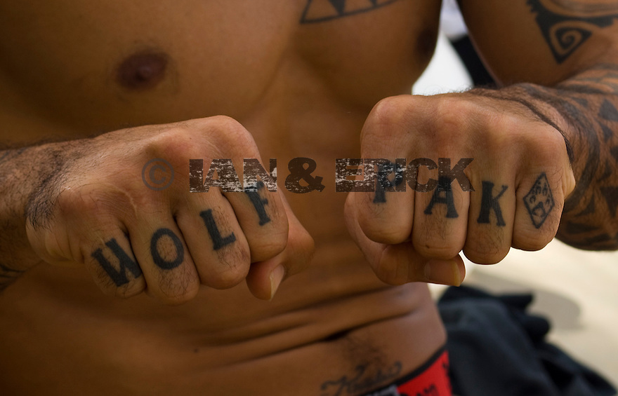 Kala Alexander showing off his fresh tatooed fist 'Wolf Pak' on the North Shore in Hawaii