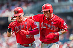 16 August 2017: Los Angeles Angels outfielder Kole Calhoun is congratulated by Mike Trout (right) after Calhoun hits a 2-run go ahead homer in the 6th inning against the Washington Nationals at Nationals Park in Washington, DC. The Angels defeated the Nationals 3-2 to split their 2-game series. Mandatory Credit: Ed Wolfstein Photo *** RAW (NEF) Image File Available ***
