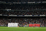 Real Madrid's and Sevilla's players observe a minute of silence in memory of the visctims of the Chile earthquake before La Liga match March 06, 2010. (ALTERPHOTOS/Alvaro Hernandez)