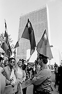 21 Sep 1971 --- Demonstration by Republic of China (ROC) (or Taiwan) supporters waving the national flag outside the U.N. building during talks for the People's Republic of China's (PRC) admission as a U.N. and permanent member of the Security Council. --- Image by © JP Laffont