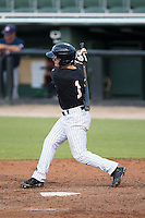 Eddy Alvarez (1) of the Kannapolis Intimidators follows through on his swing against the Hagerstown Suns at CMC-Northeast Stadium on July 19, 2015 in Kannapolis, North Carolina.  The Suns defeated the Intimidators 9-4.  (Brian Westerholt/Four Seam Images)
