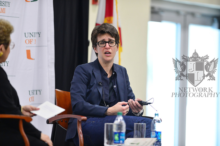 CORAL GABLES, FL - MARCH 24: MSNBC host / author Rachel Maddow (R) In conversation with U.M. President Donna E. Shalala discussing her new book 'Drift: The Unmooring of American Military Power' at University of Miami BankUnited Fieldhouse presented by Books & Books on March 24, 2013 in Coral Gables, Florida.  (Photo by Johnny Louis/jlnphotography.com)