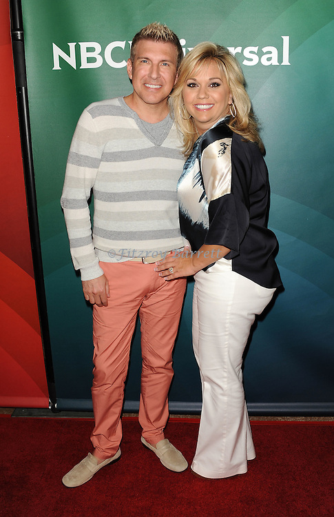 Todd Chrisley and Julie Chrisley arriving at the NBCUniversal Summer TCA 2014 Day 2 held at The Beverly Hilton Hotel Beverly Hills, CA. July 14, 2014.