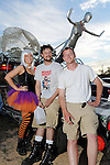 "Meg Kosowski, Adam Lutterman and Andy Rennert in front of their car ""The Apocalypse Mobil"" at the 2010 Art Car Ball at the Orange Show Monument & Warehouse Thursday May 06,2010.  (Dave Rossman Photo)"