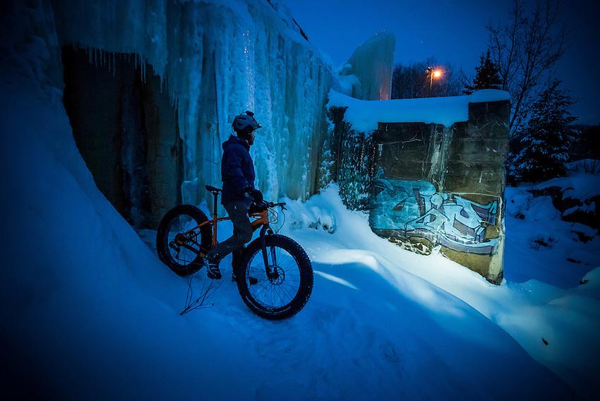 Nighttime fat bike ride on the North Snow Bike Route of the Noquemanon Trails Network in Marquette, Michigan.