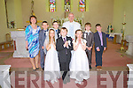 Students from  Scoil Mhuire NS who made their First Holy Communion last Saturday in Knocknagoshal, pictured front l-r: Orla Duncan, Conor Lane, Grace Cahill, back l-r: Carmel O'Connell, Michael Cahill, Jack Flaherty, Fr Mangan, Christopher Collins and Bran Deely O'Brien.