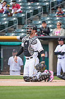 Jett Bandy (27) of the Salt Lake Bees on defense against the Reno Aces in Pacific Coast League action at Smith's Ballpark on May 10, 2015 in Salt Lake City, Utah.  Salt Lake defeated Reno 9-2 in Game One of the double-header. (Stephen Smith/Four Seam Images)