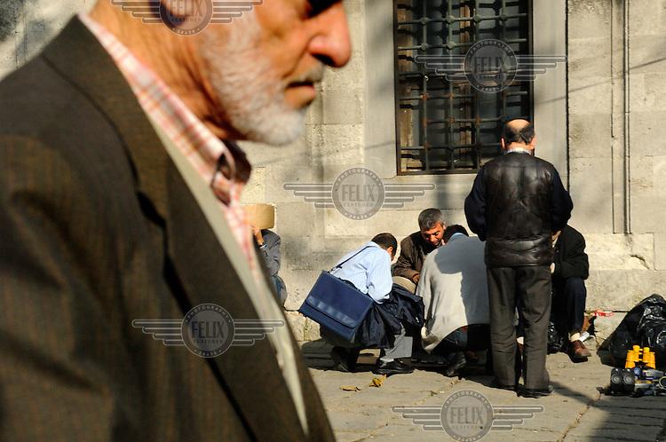 Beyazit district, an  old man passing street sellers.