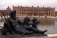 Chateau de Versailles, France, Versailles, Paris, Yvelines, Europe, Statue in the gardens outside the 17th century Chateau de Versailles.