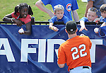 Outfielder Ryan Lollis (22) of the Augusta GreenJackets signs autographs for fans before a game against the Greenville Drive on May 23, 2010, at Fluor Field at the West End in Greenville, S.C.