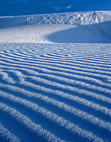 796650022v low angled afternoon light creates a three-dimensional effect in the dune ripples in the gypsum dunes of white sands national monument in new mexico