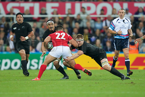 09.10.2015. St James Park, Newcastle, England. Rugby World Cup. New Zealand versus Tonga. An elbow in the face for New Zealand All Black hooker Dane Coles by Tonga centre Viliami Tahitu'a.