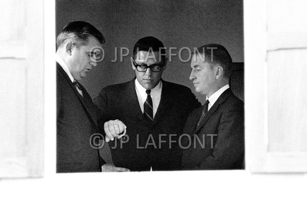 Vientiane, Laos. April 1970. Businessman Ross Perot (R), founder of Electronic Data Systems, Inc., and two of his EDS employees, Tom Marquez and Murphy Martin, wait to speak with the Pathet Lao ambassador inside the embassy in Vientiane, North Vietnam after Perot visited a Prisoners of War camp. Perot was appointed by United States Secretary of the Navy John Warner to report on the conditions of Americans in Vietnamese and Laotian POW camps for four years, until the prisoners were released in 1972 at the end of the Vietnam War.