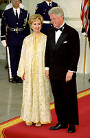 ***FILE PHOTO*** Bill Clinton Has Not Apologized To Monica Lewinsky And Claims Did The Right Thing Staying In Office.<br /> <br /> United States President Bill Clinton, right, and first lady Hillary Rodham Clinton, left, stand on the North Portico of the White House in Washington, D.C. awaiting the arrival of King Mohammed VI and HRH Princess Lalla Meryem of Morocco for a State Dinner in the King's honor at the White House in Washington, DC on June 20, 2000. <br /> CAP/MPI/RS<br /> &copy;RS/MPI/Capital Pictures