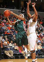 Jan. 6, 2011; Charlottesville, VA, USA; Miami Hurricanes guard Riquna Williams (1) shoots in front of Virginia Cavaliers forward Telia McCall (30) during the game at the John Paul Jones Arena.  Mandatory Credit: Andrew Shurtleff