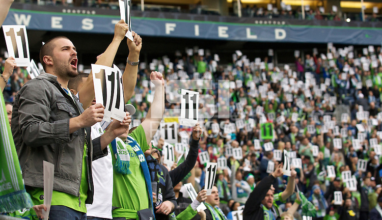 Seattle Sounders FC fans hold up signs during the eleventh minute to show their support of Steve Zakuani, who broke his leg in a previous game during play between the Seattle Sounders FC and Toronto at Qwest Field in Seattle Saturday April 30, 2011. The Sounders won the game 3-0.
