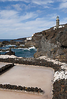 Spain, Canary Islands, La Palma, the southernmost point near Los Canarios Fuencaliente, Punta de Fuencaliente: sea salt production at world biosphere reserve of La Palma - Las Salinas de Fuencaliente, old lighthouse Faro de Fuencaliente