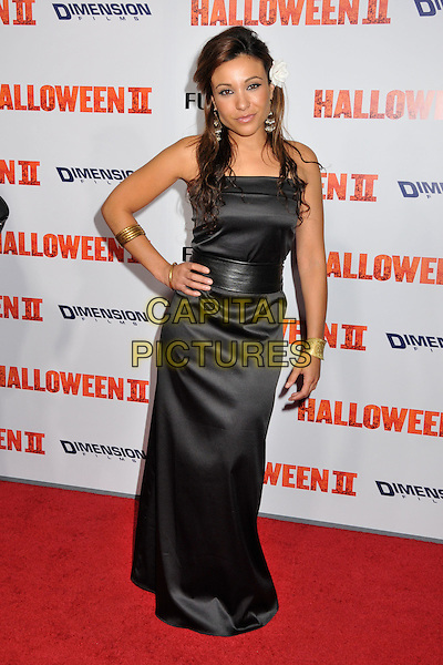 "LESLIE LOPEZ.""Halloween II"" Los Angeles Premiere held at Grauman's Chinese Theatre, Hollywood, CA, USA..August 24th, 2009.full length hand on hip black strapless white flower in hair dress log maxi .CAP/ADM/BP.©Byron Purvis/AdMedia/Capital Pictures."