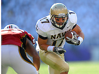 Navy's Mike Stukel looks to gain more yards against a Maryland defender. Maryland defeated Navy 17-14 at the M&T Bank in Baltimore, MD on Monday, September 6, 2010. Alan P. Santos/DC Sports Box