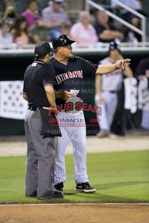 Kannapolis Intimidators manager Tommy Thompson (39) discusses a call with home plate umpire Grant Conrad during the game against the Greensboro Grasshoppers at CMC-Northeast Stadium on June 11, 2015 in Kannapolis, North Carolina.  The Intimidators defeated the Grasshoppers 7-6.  (Brian Westerholt/Four Seam Images)