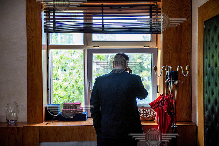 The new mayor or Pristina (Prishtina) Shpend Ahmeti speaks on the phone in his office.