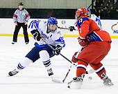 Toni Rajala (Finland - 21), Andrey Sergeev (Russia - 11) - Russia defeated Finland 4-0 at the Urban Plains Center in Fargo, North Dakota, on Friday, April 17, 2009, in their semi-final match during the 2009 World Under 18 Championship.