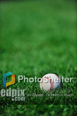 25 September 2010: A baseball lies on the grass during batting practice prior to a game between the Washington Nationals and the Atlanta Braves at Nationals Park in Washington, DC. The Braves shut out the Nationals 5-0 to even their 3-game series at one win apiece. The victory was the 2500th career win as an MLB manager for Braves' skipper Bobby Cox. Cox will retire at the end of the 2010 season, crowning a 29-year managerial career. Mandatory Credit: Ed Wolfstein Photo