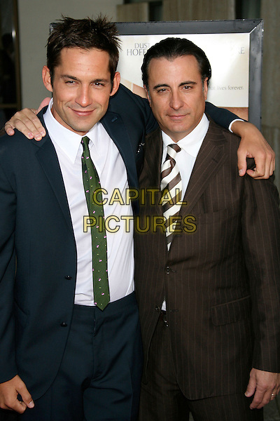 "ENRIQUE MURCIANO & ANDY GARCIA.""The Lost City"" Los Angeles Premiere - Arrivals held at the Arclight, Hollywood, California, USA..April 17th, 2006.Photo: Zach Lipp/AdMedia/Capital Pictures.Ref: ZL/ADM.half length brown pinstripe suit jacket blue arms over shoulder.www.capitalpictures.com.sales@capitalpictures.com.© Capital Pictures."