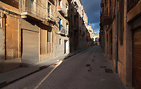 Narrow streets of the old town or Casc Antic of Tortosa, Tarragona, Spain. Tortosa is an ancient town situated on the Ebro Delta which has a rich heritage dating from Roman times. In recent years, many buildings in the old town have been abandoned and fallen into disrepair. Picture by Manuel Cohen