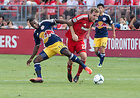 20 July 2013: New York Red Bulls midfielder/forward Marius Obekop #13 and Toronto FC forward Jeremy Brockie #22 in action during an MLS regular season game between the New York Red Bulls and Toronto FC at BMO Field in Toronto, Ontario Canada.<br /> The game ended in a 0-0 draw.
