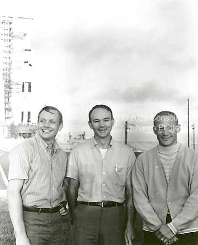 Cape Canaveral, FL - (FILE) -- On May 20, 1969, the National Aeronautics and Space Administration's (NASA) Apollo 11 flight crew, Neil A. Armstrong, commander, left; Michael Collins, command module pilot, center; and Buzz Aldrin, lunar module pilot, right, stand near the Apollo/Saturn V space vehicle that would eventually carry them into space on July 16,1969..Credit: NASA via CNP
