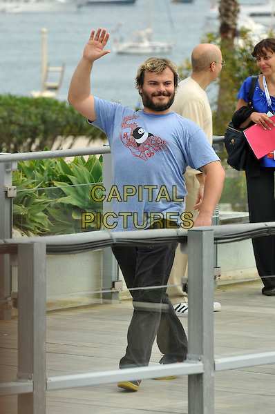 "JACK BLACK.Leaving the ""Kung Fu Panda"" photocall at the 61st Cannes International Film Festival, Cannes, France..15th May 2008 .full length blue t-shirt walking black jeans denim beard facial hair arm in air hand palm waving funny .CAP/PL.© Phil Loftus/Capital Pictures"