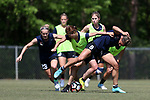 CARY, NC - APRIL 20: Yuri Kawamura (JPN) (20) and Lynn Williams (9) challenge for the ball as Kristen Hamilton (23) and McCall Zerboni (behind, right) join the play. The North Carolina Courage held a training session on April 20, 2017, at WakeMed Soccer Park Field 7 in Cary, NC.
