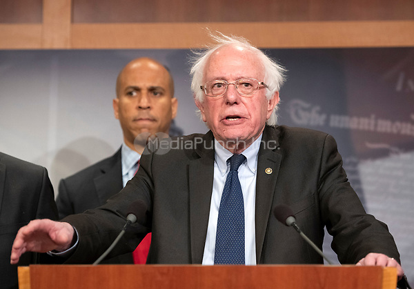 United States Senator Bernie Sanders (Independent of Vermont) makes remarks at a press conference in the US Capitol in Washington, DC announcing a Democratic package of three bills to be introduced in the US Senate and US House to control prescription drug prices on Thursday, January 10, 2019.  Standing behind Senator Sanders is US Senator Cory Booker (Democrat of New Jersey).<br /> Credit: Ron Sachs / CNP /MediaPunch