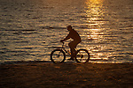 Hammonasset State Beach Park. Long Island Sound. Man on trail bike designed for beach.