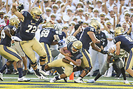 Annapolis, MD - September 8, 2018: Navy Midshipmen quarterback Malcolm Perry (10) scores a touchdown during the game between Memphis and Navy at  Navy-Marine Corps Memorial Stadium in Annapolis, MD.   (Photo by Elliott Brown/Media Images International)