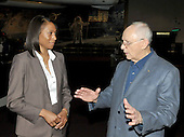 Jeannette Epps, a member of the Astronaut Class of 2009, left, meets former Astronaut  Alan L. Bean, a veteran of Apollo 12 and the first Skylab mission, right, at the National Air and Space Museum in Washington, D.C. on Friday, July 17, 2009.<br /> Credit: Ron Sachs / CNP