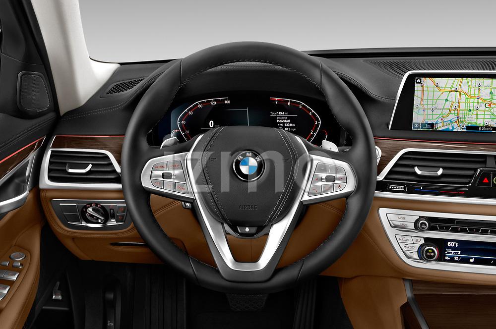 Car pictures of steering wheel view of a 2020 BMW 7 Series 740i Luxury 4 Door Sedan