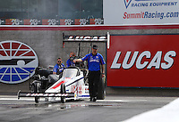 Apr 10, 2015; Las Vegas, NV, USA; Crew chief Aaron Brooks motions NHRA top fuel driver Richie Crampton forward to do his burnout during qualifying for the Summitracing.com Nationals at The Strip at Las Vegas Motor Speedway. Mandatory Credit: Mark J. Rebilas-