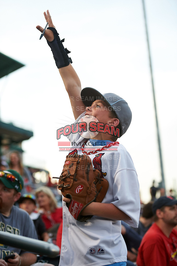 Springfield Cardinals young fan yells for a promotional giveaway in between innings during a game against the Frisco RoughRiders  on June 3, 2015 at Hammons Field in Springfield, Missouri.  Springfield defeated Frisco 7-2.  (Mike Janes/Four Seam Images)