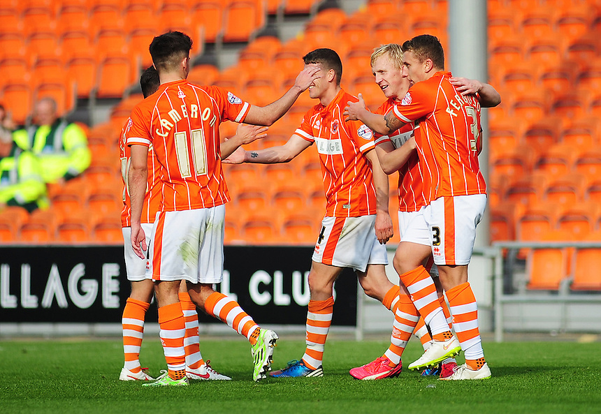 Blackpool's Mark Cullen (2nd right) celebrates scoring his sides first goal <br /> <br /> Photographer Kevin Barnes/CameraSport<br /> <br /> Football - The Football League Sky Bet League One - Blackpool v Swindon Town - Saturday 3rd October 2015 - Bloomfield Road - Blackpool<br /> <br /> &copy; CameraSport - 43 Linden Ave. Countesthorpe. Leicester. England. LE8 5PG - Tel: +44 (0) 116 277 4147 - admin@camerasport.com - www.camerasport.com