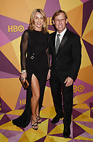 BEVERLY HILLS, CA - JANUARY 07: Former gymnasts Nadia Comaneci (L) and Bart Conner arrive at HBO's Official Golden Globe Awards After Party at Circa 55 Restaurant in the Beverly Hilton Hotel on January 7, 2018 in Los Angeles, California.